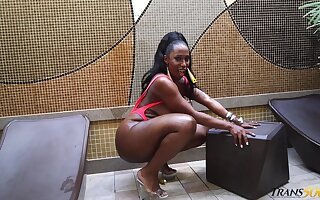 Black transsexual whore Jackeline Boing exposes her big ass and goes solo